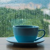 Coffee cup on wooden table with rain Wallpaper