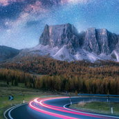 Milky Way over mountain road Wallpaper